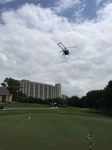 A helicopter flies over the course at Champions Circle